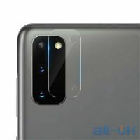 Поклейка защитной пленки на камеру  смартфона